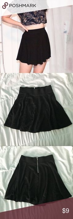 """Basic Black Skater Skirt (H&M) THIS is that basic black high waisted skater skirt that you have been looking for! Add this staple wardrobe piece to your closet and you will not be disappointed. It is from H&M under the """"Divided"""" brand, and has a nice little zipper detail in the back. Super flowy and twirly! Laying down, this skirt measures 15.5 inches in length, and a waist circumference of about 23 inches :) H&M Skirts Circle & Skater"""
