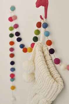 combo Christmas garland, with felt balls, yarn balls, and felt flowers....
