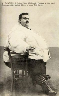 "The Dutch Giant    Here is an old postcard from my collection featuring Cannon, ""The Dutch Giant,"" who weighed in at more than 700 pounds by the time this photograph was taken. Due to his size, he was able to earn a living as a sideshow attraction in traveling carnivals and circuses."