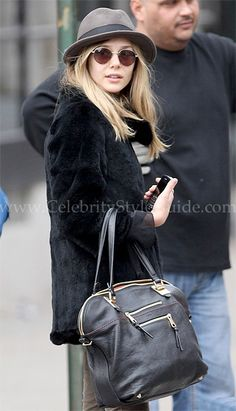 Elizabeth Olsen is obsessed with her Chloé Angie medium leather tote and I can see why. Crafted from luxe leather in a rich wear-with-everything shade, Chloé's dark-brown 'Angie' tote is a true classic. The clean shape is punctuated by lustrous gold hardware, creating a covetable combination. Take your cues from the style elite and carry this must-have accessory against polished city looks.