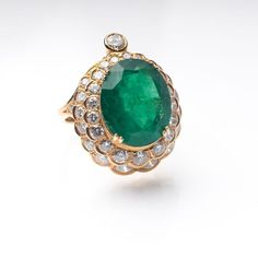Smaragd-Brillant-Ring 18 kt. GG, gest. Smaragd im Ovalschliff ca. 11,40 ct. (ca. 16,5 x 14 x 8,1 mm)