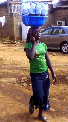 Trader in Nigeria--I guess the buyer has to provide his/her own drinking cup, ah?