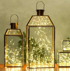 Lanterns Filled with White Christmas Lights, Nontraditional Holiday Decor, Gardenista - Have Fairy Lights (Battery-powered LEDs) in Jam Jars on Tables? Outdoor Christmas, Christmas Crafts, Christmas Lanterns, Christmas Holiday, Magical Christmas, Christmas Wedding, Indoor Christmas Lights, Simple Christmas, Christmas Garlands