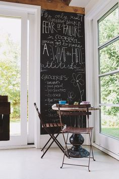 Eating nook with chalkboard paint on the walls