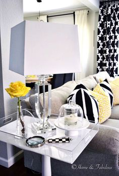 Give your side table a modern twist by adding an acrylic tray on top and crystal lamp like this one from @homegoods (sponsored pin)