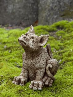 """Cute dragon statue. This little guy is looking up, an expectant look on his face. Perhaps waiting for someone to play with him? He is 11"""" tall and comes in several different finishes. Click dragon for more info. Affiliate Link."""