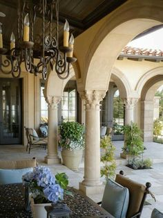 Mediterranean home, veranda, outdoor chandelier. Tuscan dream home