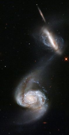 Arp 87 and the two spiral galaxies NGC 3808 and NGC 3808A, are in an early state of merging. Already a bridge between them has formed. A polar ring around NGC 3808A attests to a former fusion of galaxies. Constellation: Leo. Distance: 300 million light-years. Visual magnitude: 14.1. Type: Sc D.