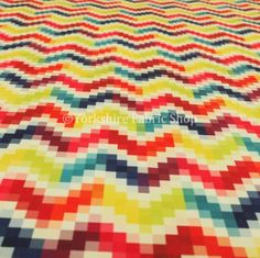 This #geometric #rainbow #fabric is just glorious! What better way to bring #colour into a room!
