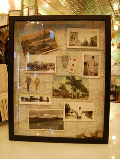Travel memorabilia in a shadowbox frame.