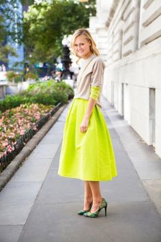 Mary Kate Steinmiller, senior fashion market editor of Teen Vogue. Neon in a classic full skirt / dress,  neutral color cardigan, and paisley pumps.
