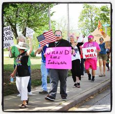 Individuals with Grand Lake Indivisible are out today demonstrating in support of the national Tax Day March calling on President Donald J. Trump to be transparent with his taxes. The group is walking up and down Third Street in Grove during its march. (KMHM)