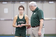 Head coach Craig Hougen offers advice to Sara Chruness during the Beaver Classic Feb. 6, 2012.