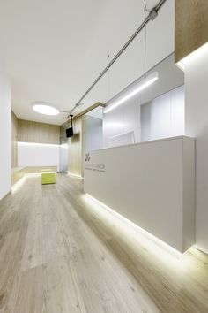 Dental Clinic Adriana García / NAN arquitectos Completed in 2015 in Pontevedra, Spain. Images by Iván Casal Nieto. The main problem in this project was fit the extensive program to the reduced area, only 62 square meters. Three areas have been differentia Clinic Interior Design, Clinic Design, Commercial Interior Design, Commercial Interiors, Dental Office Decor, Medical Office Design, Healthcare Design, Dental Offices, Dental Reception