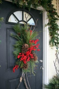Berries and pinecones on a Christmas porch swag Christmas Swags, Christmas Door, Outdoor Christmas Decorations, Country Christmas, Winter Christmas, Christmas Holidays, Christmas Crafts, Holiday Decor, Primitive Christmas