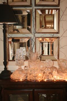 Crystal bowls glow from the string of lights underneath.