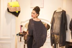 This one looks very interesting. Knitted cape, can be worn as a top layer on your winter coat.