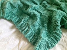 This blanket is cloud soft and super cozy. Hand knit using super soft acrylic yarn; all machine washable/dryable. This stunning blanket is a tone on