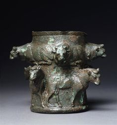 Vase decorated with bulls and horses in high relief. ca. 1300 BC, Susa