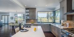 Across the open expanse, the kitchen wraps around a corner of the home. Light…