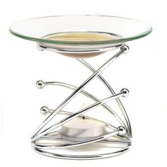 """by Fragrance Foundry Fascinating swirls of gleaming sculpted silver come together in a masterpiece of modern art, supporting a sleek glass dish above a candles golden flame. More than just a theatrical decoration, this sophisticated sculpture is an elegant fragrance diffuser when your favorite scented oil is warmed by the glowing tealight below. Oil and candle not included. 5"""" x 5"""" x 3.75"""" allgooddecor.com  #allgooddecor #decor #candles #accents #figurines #furniture #gifts #decorations"""