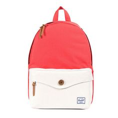 This mid-volume backpack is perfect for smaller size frames, and comes in a Salmon and Bone colorblock design with a wooden button detail.