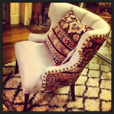 Photo by Royal Bohemian- Vintage Chairs and Throw Pillows with Antique Persian Rugs, the ethnic pattern feels exotic yet decadent.