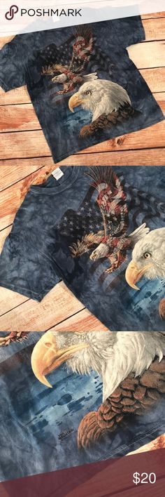 """▪️v i n t a g e : """"the mountain"""" eagle t-shirt v i n t a g e : blue tiedye-ish THE MOUNTAIN brand American flag and eagle graphic t-shirt.. I am beginning  to really like this brand. This one is unique. Very good condition, slight fading  from wash, but a very quality shirt  at that. Size large.  —- #shopping #gift #present #vintage #vtg #retro #clearance #sale #bogo #deal #freeship #themountain #american #flag #eagle #pride #merica #acidwash Vintage Shirts Tees - Short Sleeve"""