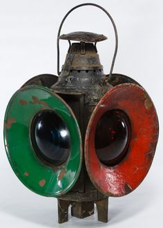 Lot 418: Dressel Railroad Switch Lamp; Having two blue lights, two red lights, four reflectors and the maker mark on the cap