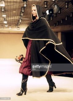 A model displays clothes created by French stylist Yves Saint Laurent 29 March 1977 for the readytowear collection AutumnWinter 19771978