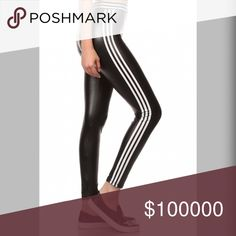 Amazing faux leather mod leggings High waisted tummy flattening gorgeous black faux leather quality leggings with varsity stripes! We love!! ❤️️ Pants Leggings