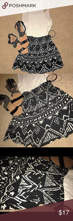 Forever 21 black n white swing/skater aztec skirt This Forever 21 black n white swing/skater aztec skirt is in great condition and is a great staple piece, I've worn it with booties and cardigans or sandals and thin tanks in the summer. Either way this beauty needs a new home! Make it yours! Forever 21 Skirts Circle & Skater
