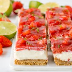 These moreish Strawberry and Rhubarb Cheesecake Bars are topped with a delicious homemade jelly topping! No baking required. The perfect make ahead dessert!  #strawberrydessert #rhubarb #cheesecake #nobakecheesecake #summerdessert