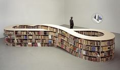 While Job Koelewijn's infinity-sign-shaped bookcase won't actually hold an infinite number of books, it does hold a lot. Aside from looking cool, the design has a deeper meaning too, representing the infinite knowledge that can be gained from books.