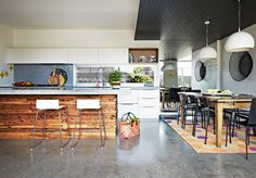 Love the mix of materials - the floor, the island/peninsula, and the counter top. sigh.....