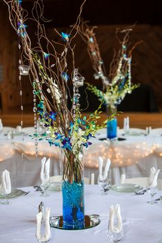 Pretty Tall Centerpieces with blue orchids  Photo: by Cariad Photography