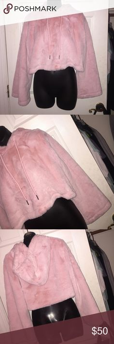 Gorgeous Faux fur cotton candy pink crop hoody.  Amaazzzinggg never worn !!!! Feels so soft and the inside doesn't have a itchy material. It really feels like real fur.  only ASOS brand for exposure. ✨✨☺️ ASOS Tops Sweatshirts & Hoodies