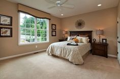 Beautiful master bedroom with a huge window.