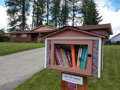 For this little free library we added a touch of brick on the front then painted it to match, used chocolate colored lap siding on both sides, and the crowning touch was the 3D printed unique gable design, making it a perfect addition to its new home on the 10700 Block of East 19th in the Spokane Valley. Built by Little Library Builder of Spokane! www.littlelibrarybuilder.com Little Free Libraries, Little Library, Free Library, Library Books, Spokane Valley, Chocolate Color, Pretty Little, Brick, Shed