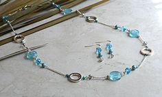 Silver and Blue Necklace and Earring Set. Mix of glass, crystal, and metal beads.