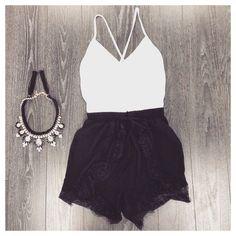 white criss cross tank top, black ruffle soft shorts + necklace