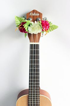 This is ribbon lei for ukulele. This is the head accessories for ukulele. made of ribbon. the flower name is hibiscus.  Size is free.  Also available for key ring of the ukulele gig bag.  When you play in concert, this ribbon lei make it look nice ukulele.  But,this flower decoration is not only very cute. There is the effect of suppressing the noise of ukulele head portion. (In fact, there is a product to suppress the noise of the head portion is also for guitar and bass guitar.)   It is…