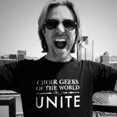 We   Amazing Eric Whitacre who is inspiring all Choir Geeks of the World to UNITE!!