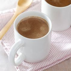 Paleo peppermint hot chocolate recipe made with coconut milk and cacao powder. It's rich, creamy, and completely dairy-free.