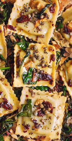 Italian Ravioli with Spinach, Artichokes, Capers, Sun-Dried Tomatoes. The vegetables are sautéed in olive oil. Meatless, refreshing, Mediterranean style pasta recipe that doesn't need any meat – this meal will keep you full! #Italian #dinner #recipe #ravioli #Italianravioli #Italianpasta #Italiandish #Mediterraneanfood #Mediterraneanrecipe #Mediterranean