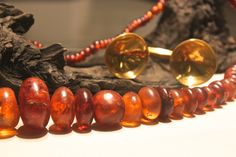 An Amber necklace and a gold dress fastener. 800-700 BC. Ireland.