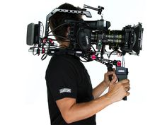 DP André Perron with his Canon #EOS #C300 full set up including - SHΛPE 7000 V-LOCK QUICK RELEASE BASE PLATE - Preston Micro force system and SHΛPE Micro force Adaptor - #Alphatron - CHEESE PLATE - PAPARAZZI I HANDLE ROD BLOC  #c300rig #c300shoulderrig #c300shouldermount #canoneosc300 #shoulderrig #rig Camera Rig, 35mm Camera, Camera Gear, Digital Cinema, Magic Design, Cinema Camera, Camera Equipment, Video Camera, Reality Tv