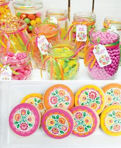 brightly colored candy and flower printed or decorated sugar cookies