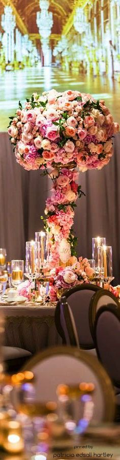 low flowers, gold candles, big double sided photo