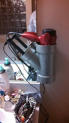 Storage Solutions All Around the House • Great Ideas and Tutorials! Including this creative idea for a diy hair dryer / curling iron holder!